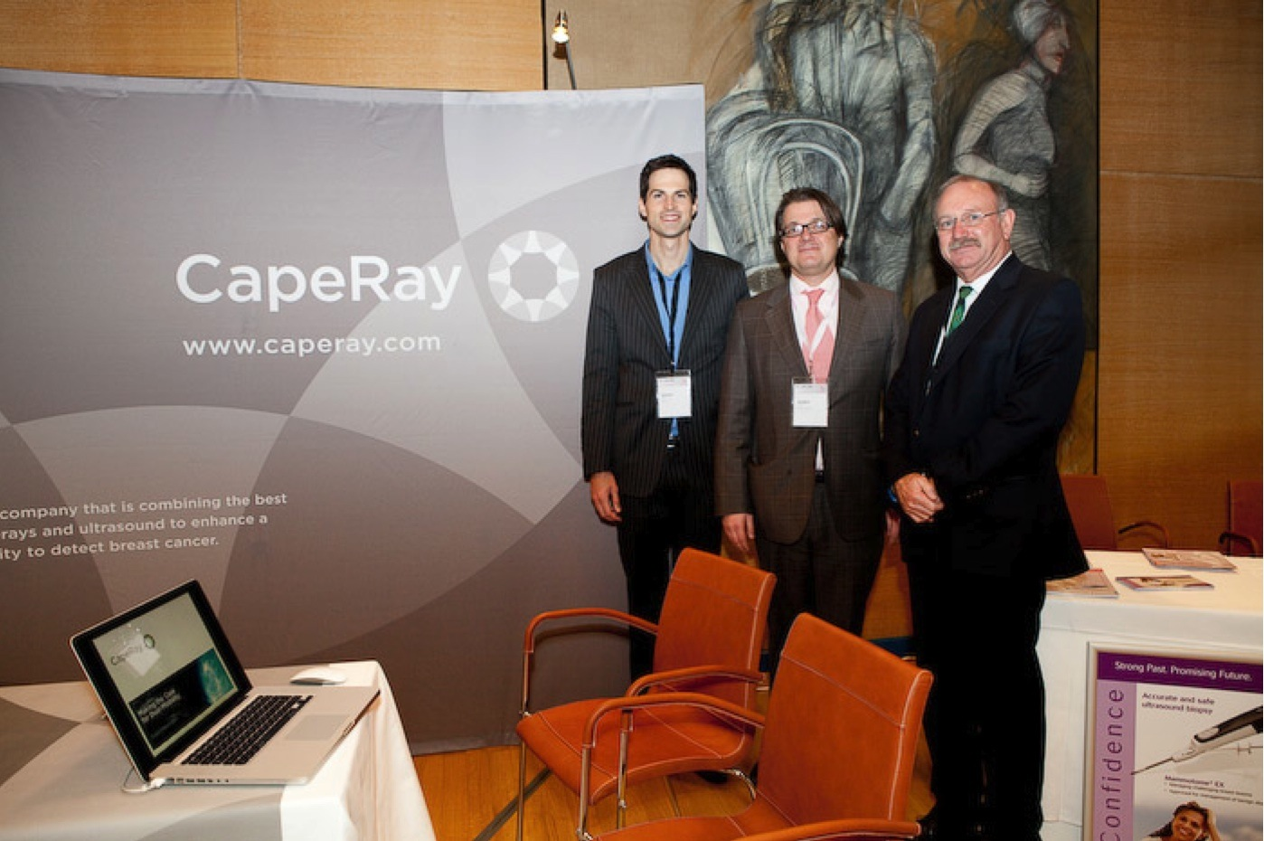 Roland Baasch (left) and Kit Vaughan (right) with Prof. Thomas Helbich (centre), president of EUSOBI, at the CapeRay exhibit.