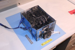A burnt out lithium-ion battery removed from a Dreamliner. Copyright Reuters.
