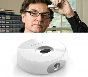 Walter de Brouwer, CEO of Scanadu, holds the Scout between his thumb and index finger.
